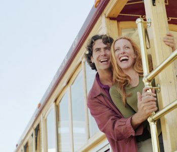 Smiling Couple Riding Cable Car